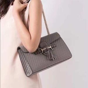 Gucci Emily GG Micro Shoulder Lousse Leather bag